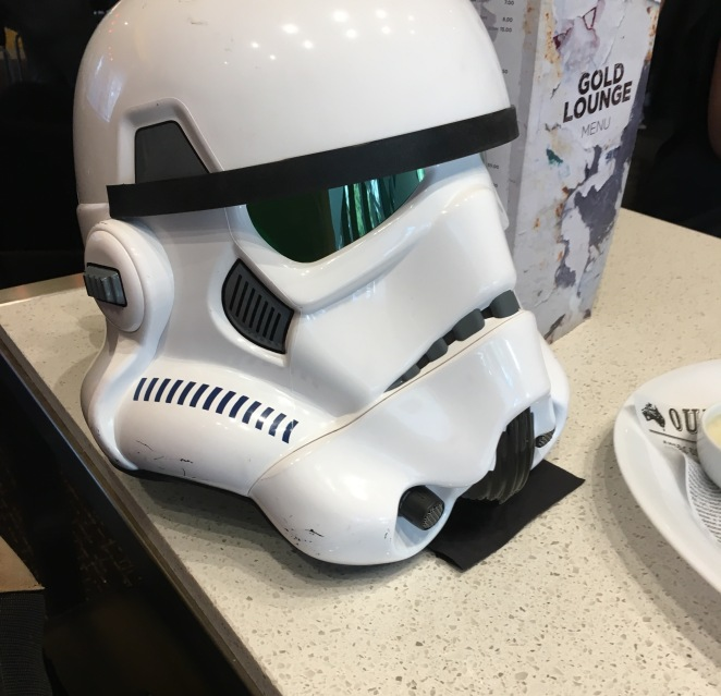 stars wars helmet in gold class lounge